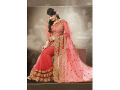 An Eye-Catching Peach Color Soft Net Saree With Heavy Emb.